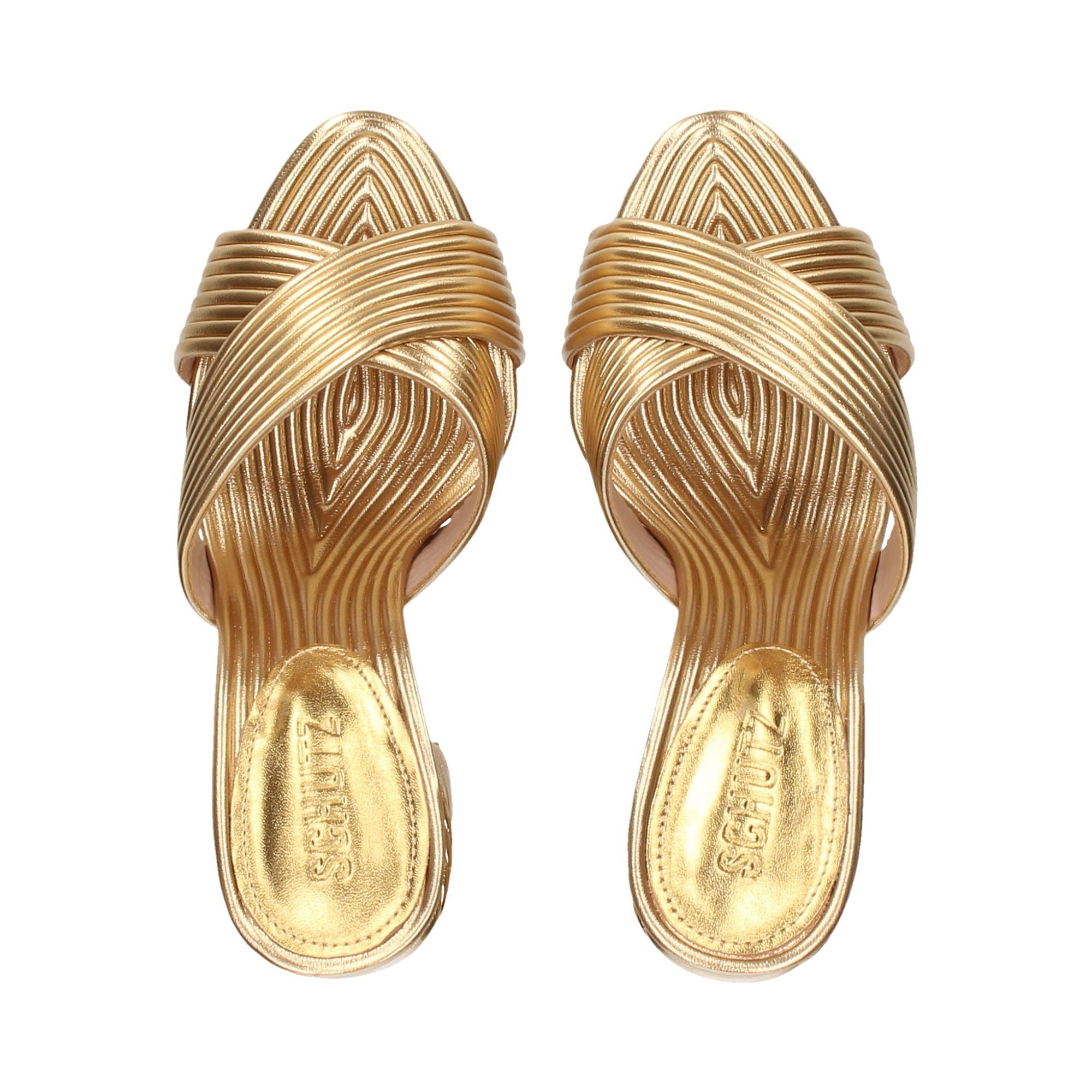 pala-tiritas-cruzadas-metalizada-oro